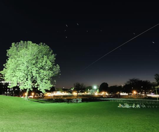 Long exposure shot of the Space Station flying overhead